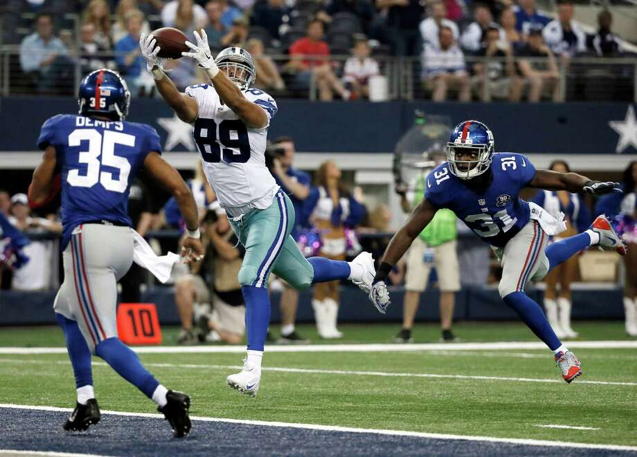 New York Giants' Quintin Demps (35) and Zack Bowman (31) defend as Dallas Cowboys tight end Gavin Escobar (89) comes down with a reception for a touchdown during the second half of an NFL football game Sunday, Oct. 19, 2014, in Arlington, Texas. (AP Photo/Brandon Wade) ORG XMIT: CBS175 Photo: Brandon Wade / FR168019 AP