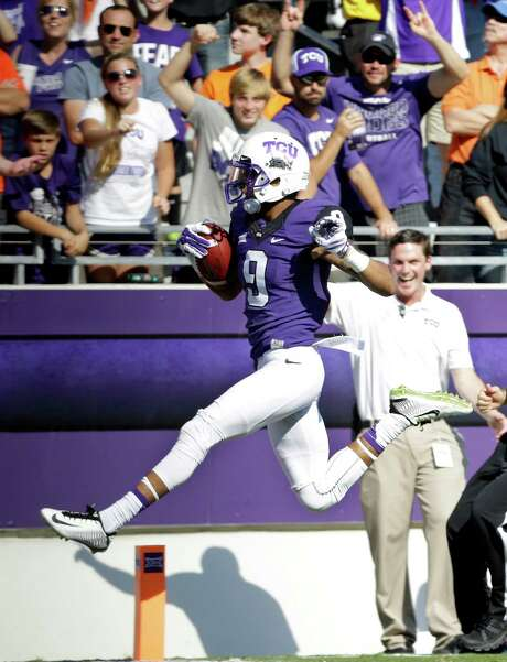 With big-play threat Josh Doctson galloping to 225 receiving yards Saturday, TCU disposed of Oklahoma State 42-9 and appears to have the most favorable remaining schedule of the Big 12 contenders. Photo: Tony Gutierrez, STF / AP