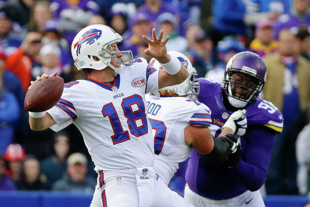 Buffalo Bills quarterback Kyle Orton (18) throws a touchdown pass to Sammy Watkins during the first half of an NFL football game against the Minnesota Vikings, Sunday, Oct. 19, 2014, in Orchard Park, N.Y.  (AP Photo/Bill Wippert) ORG XMIT: NYFF109 Photo: Bill Wippert / FR170745 AP