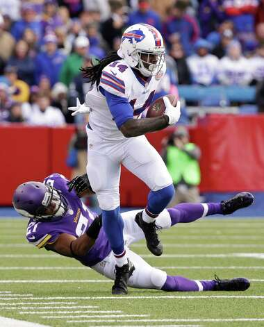Buffalo Bills wide receiver Sammy Watkins (14) breaks a tackle by Minnesota Vikings' Josh Robinson (21) during the first half of an NFL football game Sunday, Oct. 19, 2014, in Orchard Park, N.Y. (AP Photo/Bill Wippert) ORG XMIT: NYFF119 Photo: Bill Wippert / FR170745 AP