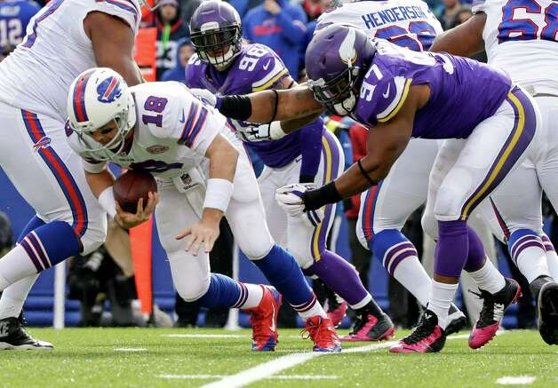 Minnesota Vikings defensive end Everson Griffen (97) sacks Buffalo Bills quarterback Kyle Orton (18) during the second half of an NFL football game, Sunday, Oct. 19, 2014, in Orchard Park, N.Y. (AP Photo/Bill Wippert) ORG XMIT: NYFF125 Photo: Bill Wippert / FR170745 AP