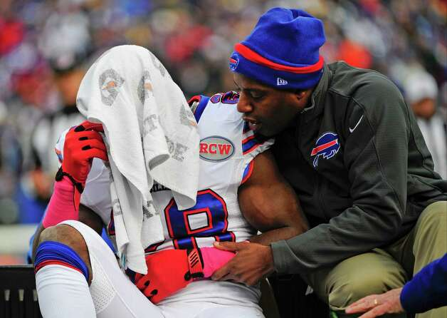 Buffalo Bills running back C.J. Spiller (28) is comforted as he is carted off the field after being injured during the first half of an NFL football game against the Minnesota Vikings, Sunday, Oct. 19, 2014, in Orchard Park, N.Y.  (AP Photo/Gary Wiepert) ORG XMIT: NYFF113 Photo: Gary Wiepert / FR170498 AP
