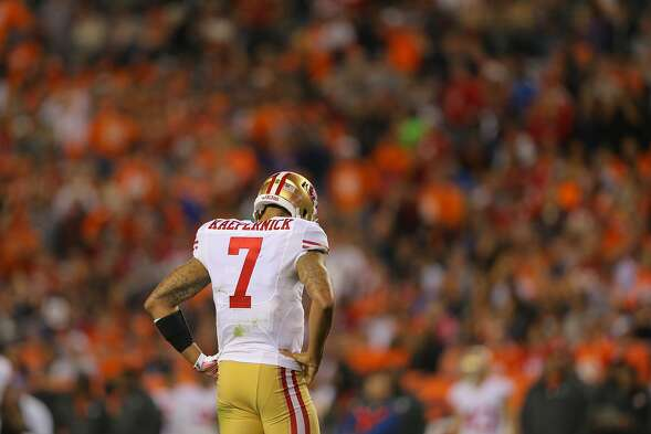 DENVER, CO - OCTOBER 19:  Quarterback Colin Kaepernick #7 of the San Francisco 49ers hangs his head in the third quarter of a game against the Denver Broncos at Sports Authority Field at Mile High on October 19, 2014 in Denver, Colorado.  (Photo by Justin Edmonds/Getty Images)