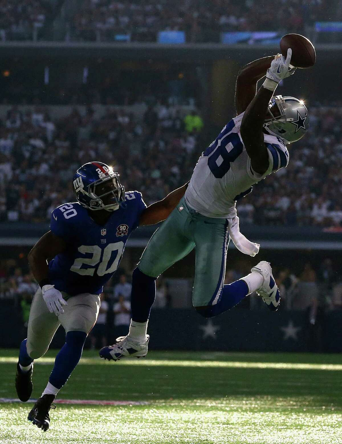 ARLINGTON, TX - OCTOBER 19: Dez Bryant #88 of the Dallas Cowboys makes a pass reception against Prince Amukamara #20 of the New York Giants in the fourth quarter at AT&T Stadium on October 19, 2014 in Arlington, Texas. (Photo by Ronald Martinez/Getty Images)