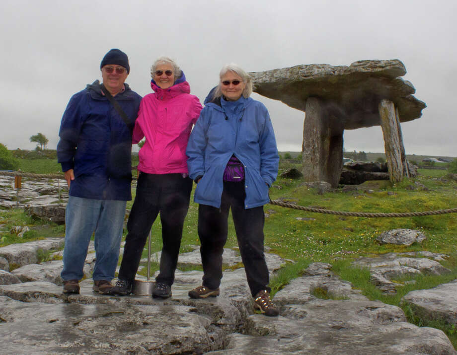 Steve Napoli of Berkeley with his wife and sister-in-law at the Poulnabrone Dolmen, a 4,000 year old portal tomb in the Burren area of Ireland. / ONLINE_YES