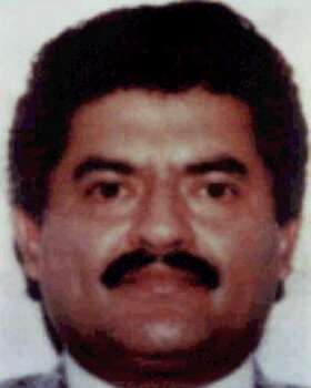 "Juan Jose Esparragoza, seen in this undated photo, is considered one of Mexico's top drug lords not behind bars, overseeing the smuggling of cocaine and marijuana into the United States since 1993. He's known on the street as ""Blue,"" but the kingpins in his inner-circle and the drug agents on his tail call him ""The Godfather."" (AP Photo/Attorney General's Office) Photo: STR, File Photos / AP2004"
