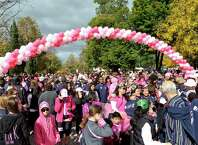 Walkers line up at the start line during the Making Strides Against Breast Cancer walk at Washington Park on Sunday, Oct. 19, 2014, in Albany, N.Y.   (Paul Buckowski / Times Union)