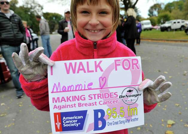 Carli O'Hara, 8, from Cohoes takes part in the Making Strides Against Breast Cancer walk at Washington Park on Sunday, Oct. 19, 2014, in Albany, N.Y.  O'Hara was walking for her grandmother, who is a breast cancer survivor.  (Paul Buckowski / Times Union) Photo: Paul Buckowski / 00029076A