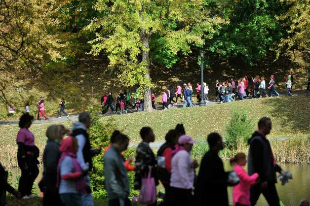 People participating in the Making Strides Against Breast Cancer walk make their way around the lake at Washington Park on Sunday, Oct. 19, 2014, in Albany, N.Y.   (Paul Buckowski / Times Union) Photo: Paul Buckowski / 00029076A