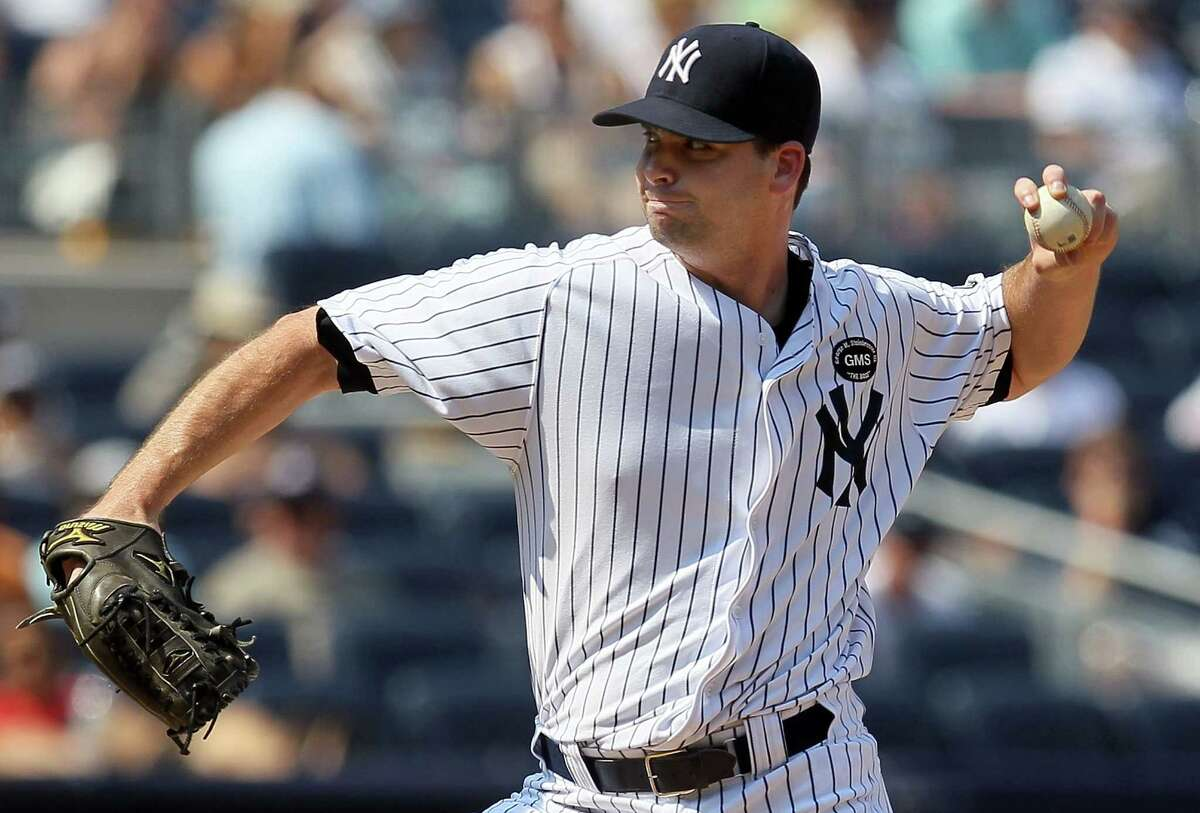 Boone Logan, O'Connor High School Logan, shown here pitching for the New York Yankees in 2010, attended O'Connor High School and later pitched for Temple College in Temple, Texas.  He was drafted by the Chicago White Sox and currently on the Colorado Rockies.