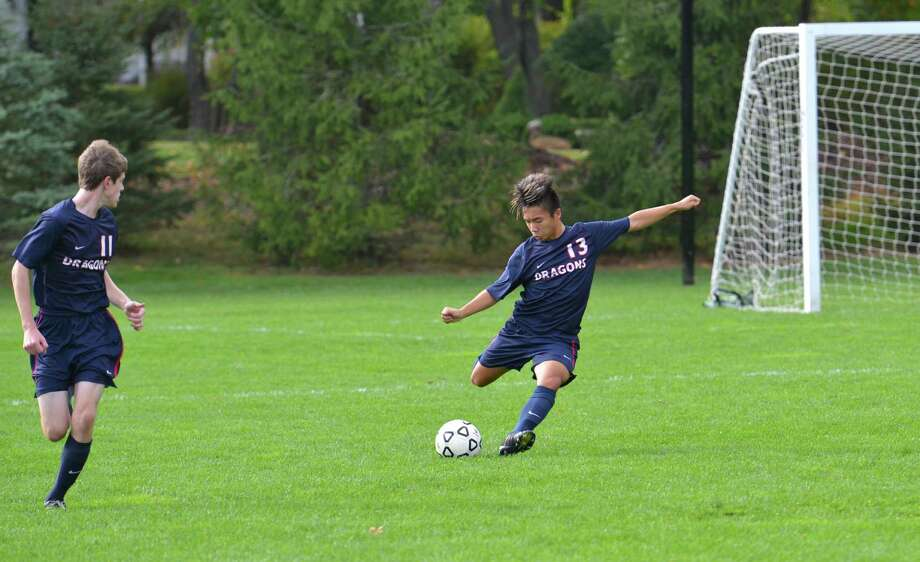 GFA junior Ben Strait clears the ball for GFA in a game against South Kent School. Strait was instrumental in his team's 2-0 win against St. Luke's during Homecoming last Saturday. Photo: Contributed Photo / Westport News Contributed