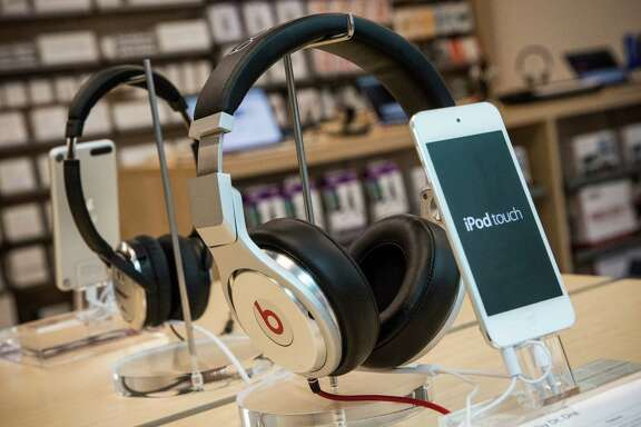 In May, Apple made moves to cement its presence in streaming. It bought luxury headphones manufacturer Beats Electronics and streaming music service Beats Music in a $3 billion deal.  Beats headphones are sold along side iPods in an Apple store on May 9, 2014 in New York City. (Photo by Andrew Burton/Getty Images)