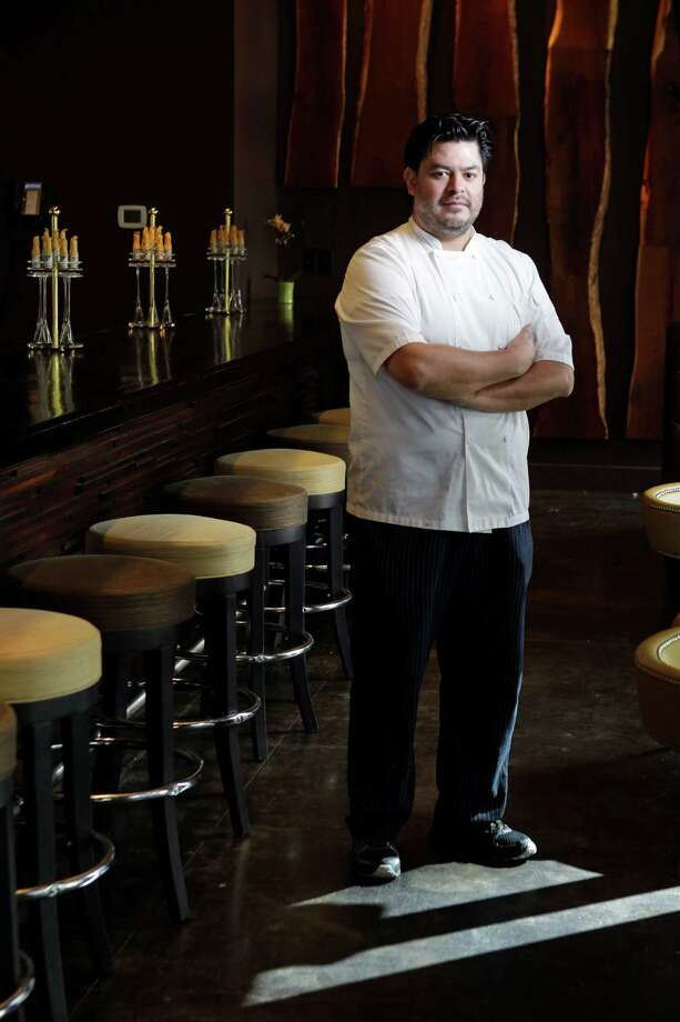 Chef Jose Hernandez poses in the bar at the new Radio Milano restaurant in the Hotel Sorella CityCentre. Photo: Melissa Phillip, Staff / © 2014  Houston Chronicle