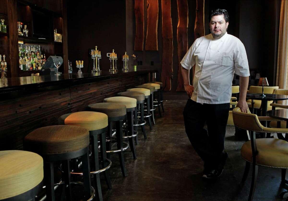 Chef Jose Hernandez poses in the bar at the new Radio Milano restaurant in the Hotel Sorella CityCentre.
