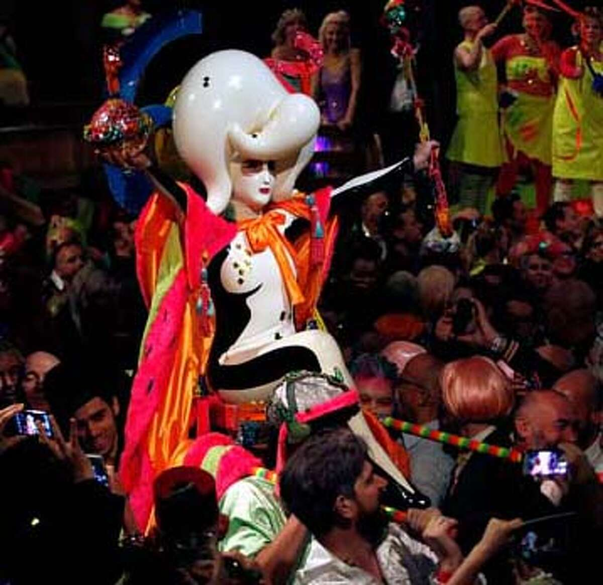 Miss Zero+ is carried around the Globe Theatre as she is crowned the winner of the Alternative Miss World 2014.
