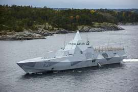 Swedish navy  corvette HMS Visby  patrols in the Stockholm Archipelago, Sweden,  Sunday Oct. 19 2014.  A Swedish military search for evidence of suspected undersea activity in its waters has entered its third day amid reports of a suspected Russian intrusion.  (AP Photo/TT News Agency / Marko Saavala)   SWEDEN OUT