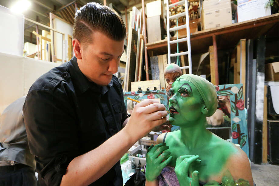 """Zachry Smith (left) applies makeup to Asia Ciaravino in her costume change from Miss Gulch into the Wicked Witch during a performance of """"The Wizard of Oz"""" Oct. 12 at The Playhouse, 800 W. Ashby Place. Photo: Marvin Pfeiffer/ Alamo Heights Weekly / Express-News 2014"""