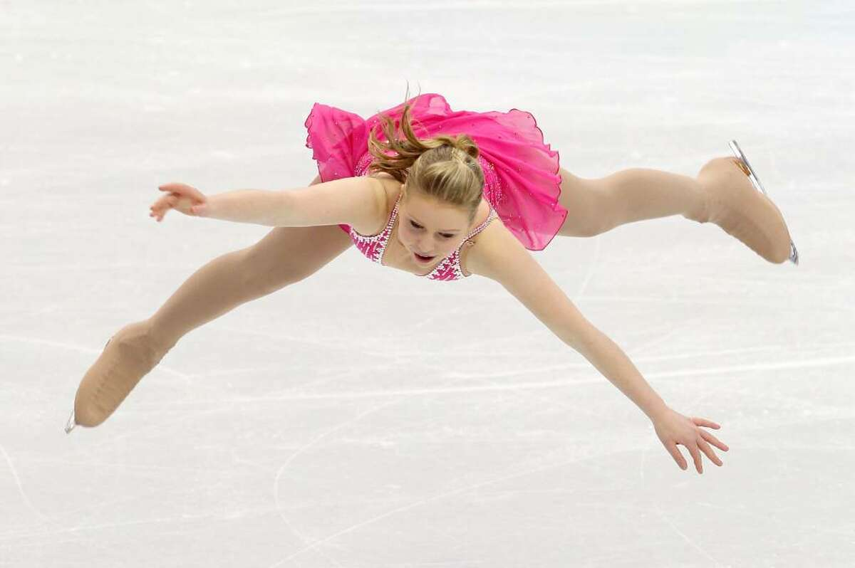 VANCOUVER, BC - FEBRUARY 23: Rachael Flatt of the United States competes in the Ladies Short Program Figure Skating on day 12 of the 2010 Vancouver Winter Olympics at Pacific Coliseum on February 23, 2010 in Vancouver, Canada. (Photo by Cameron Spencer/Getty Images) *** Local Caption *** Rachael Flatt