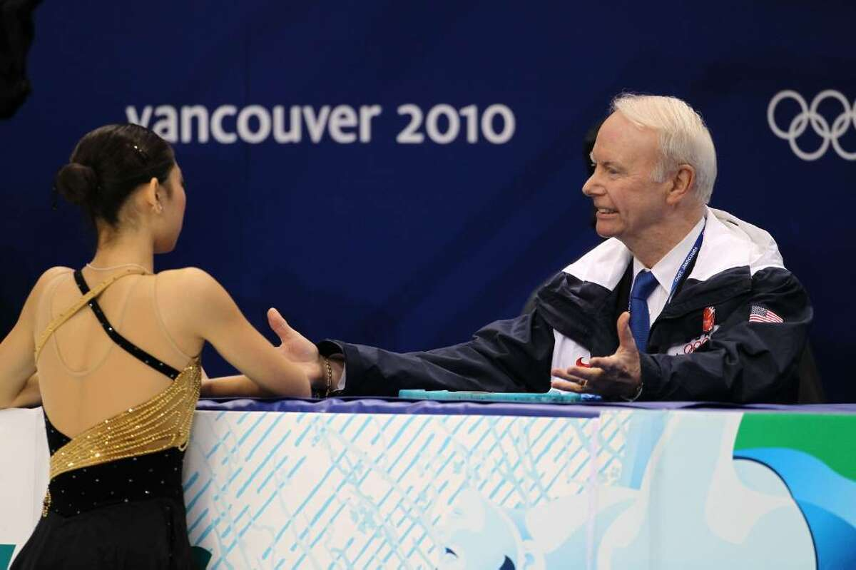 VANCOUVER, BC - FEBRUARY 23: Mirai Nagasu (L) of the United States confers with her coach Frank Carroll in the Ladies Short Program Figure Skating on day 12 of the 2010 Vancouver Winter Olympics at Pacific Coliseum on February 23, 2010 in Vancouver, Canada. (Photo by Matthew Stockman/Getty Images) *** Local Caption *** Mirai Nagasu;Frank Carroll