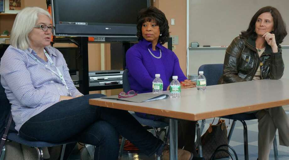 Jennifer Lawton, CEO of MakerBot, addresses Greenwich Academy students during an upper-school symposium on Monday, Oct. 20, 2014. Deb Elam, center, GE chief diversity officer, and, at right, Lisa Baird, USOC chief marketing officer, look on. Photo: Paul Schott / Greenwich Time