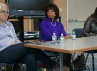 Jennifer Lawton, CEO of MakerBot, addresses Greenwich Academy students during an upper-school symposium on Monday, Oct. 20, 2014. Deb Elam, center, GE chief diversity officer, and, at right, Lisa Baird, USOC chief marketing officer, look on.