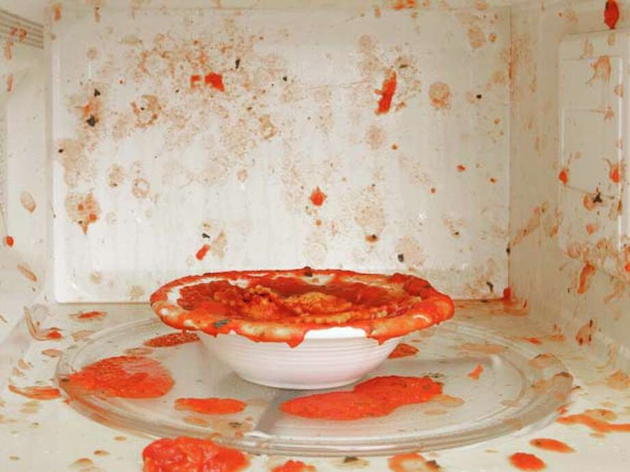 Clean up after yourself. This is the golden rule of keeping the peace in the office kitchen. It applies to every aspect of using the community eating area. If your food splatters in the microwave, wipe up the mess immediately. If you leave a mess at the table, sponge it up. For wet spills, use a cleanser so the next person to sit there doesn't end up with an elbow in an invisible sticky stain. If you dirty a dish, wash it in the sink, dry it off, and put it away.All tips provided by Diane Gottsman, etiquette expert, public speaker and owner of The Protocol School of Texas.  Photo: Steven Puetzer, Getty Images / (c) Steven Puetzer