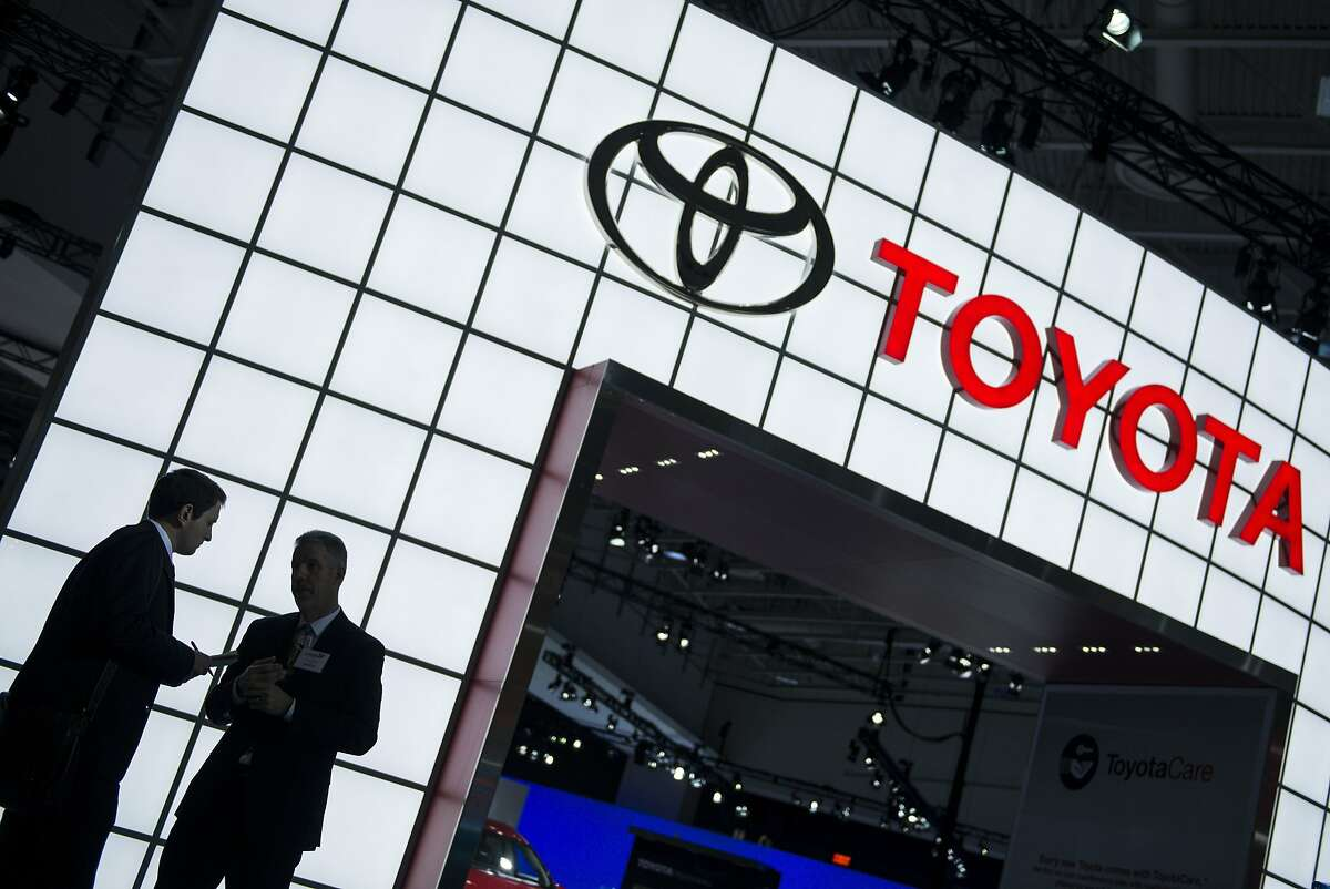 (FILES) This January 22, 2014 file photo shows people near the Toyota display during the Washington Auto Show in Washington, DC. Toyota on October 20, 2014 expanded its recall of cars facing the risk of an air bag rupturing, recalling about 247,000 cars in the United States to replace Takata Corporation-supplied parts.Toyota Motor Sales USA said it was recalling Toyota Corolla, Matrix, Sequoia, Tundra and Lexus vehicles produced from 2001 to 2004 to replace the air bag inflator for the front passenger seat. AFP PHOTO/Brendan SMIALOWSKIBRENDAN SMIALOWSKI/AFP/Getty Images