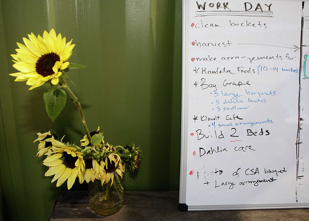 Elegant sunflowers brighten up the room next to the work - Industriel urban farm cuisine los angeles ca ...