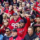 Houston Texans fans cheer as they pose for a group photo at Point State Park before the Texans game against the Pittsburgh Steelers on Monday, Oct. 20, 2014, in Pittsburgh.
