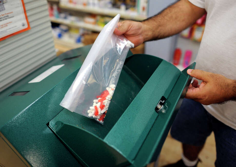 Marwan Nasrah puts unused pills into a drug disposal box at Daniel's Pharmacy in S.F. Photo: Michael Short / Special To The Chronicle / ONLINE_YES