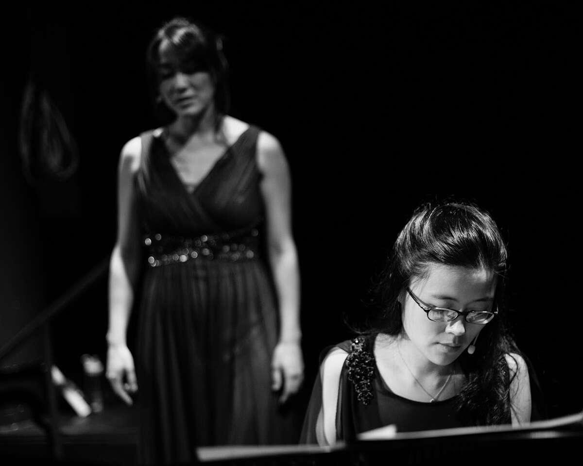 """Laura Yumi Snell, background, and Eunbi Kim perform in """"Murakami Music,"""" which was inspired by Japanese novelist Haruki Murakami."""