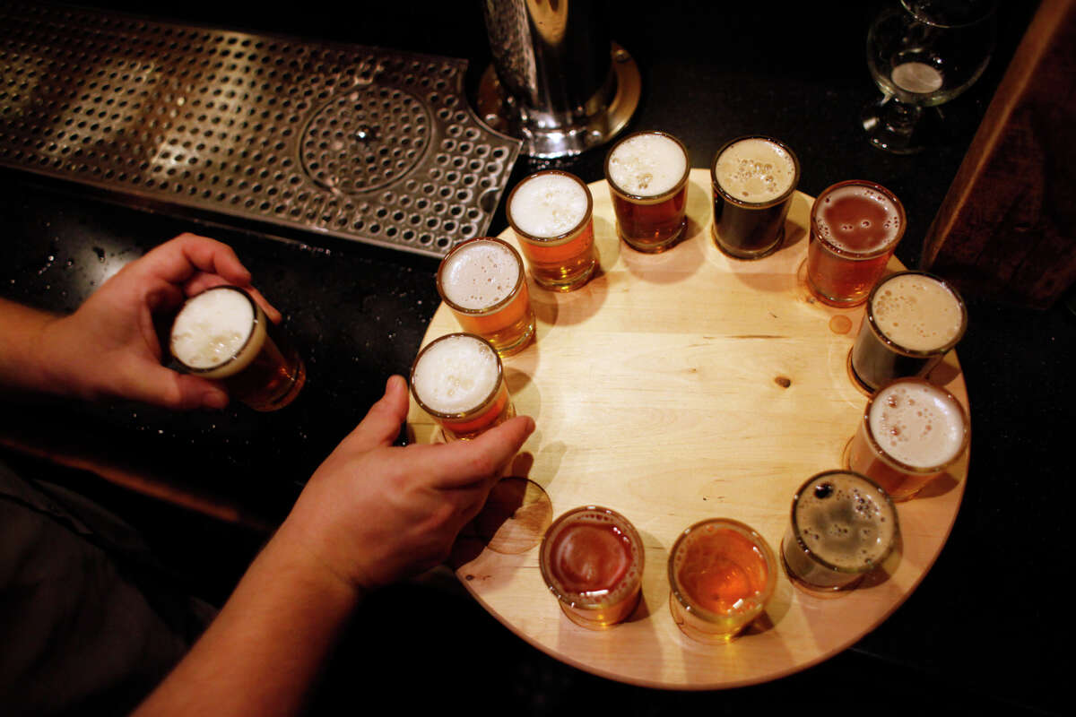 Beertenders - yes, beertenders - prepare a flight of suds at Out of Bounds Brewing Co. in Rocklin, one of many breweries in Placer County, which is experiencing a resurgence in craft beers.