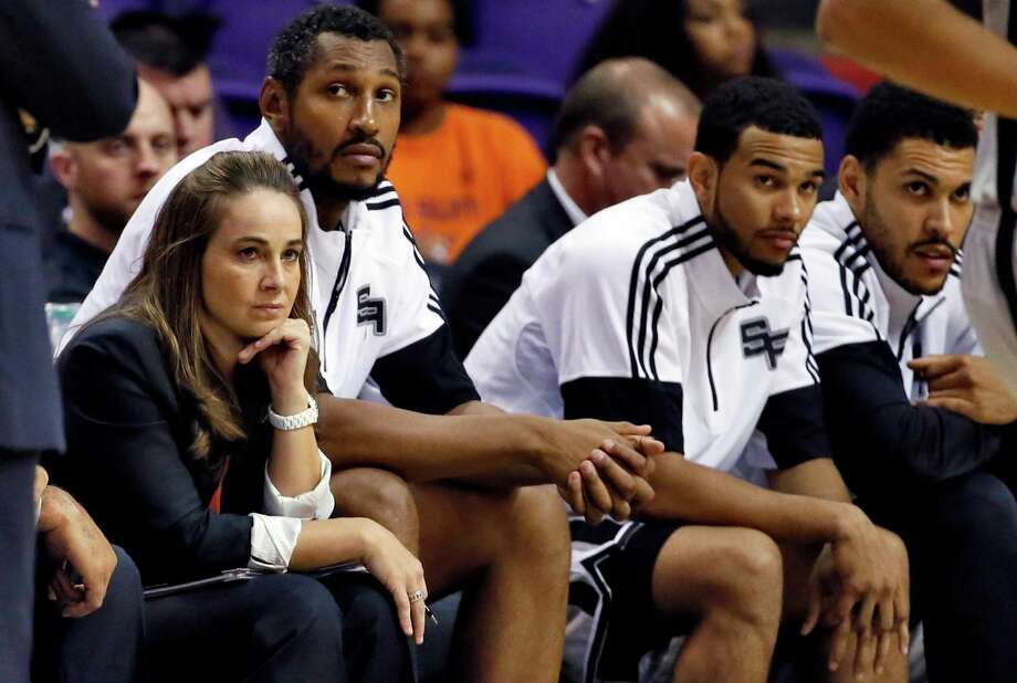 San Antonio Spurs assistant coach Becky Hammon watches during the second half of a preseason game against the Phoenix Suns. A reader says that if Hammon has input on the types of plays the Spurs run, it will shatter at least one stereotype about men. Photo: Matt York / Matt York / Associated Press / AP