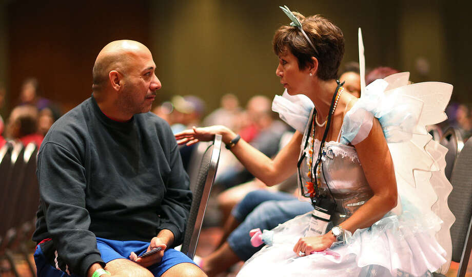 "The ""Tooth Fairy,"" Dr. Lisa Masters, right, of San Antonio, talks with Jimmy Camposano as he waits to get treatment during the Mission of Mercy clinic at the Henry B. Gonzalez Convention Center. Photo: Jerry Lara / San Antonio Express-News / © 2014 San Antonio Express-News"