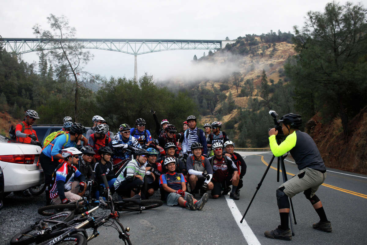 Cyclists set up a group photo last month on Old Foresthill Road in Auburn, with the Foresthill Bridge in the background. The Foresthill Bridge is the highest bridge in California√.