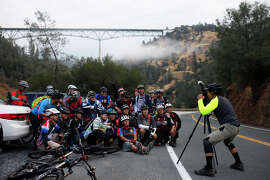 Cyclists set up a group photo last month on Old Foresthill Road in Auburn, with the Foresthill Bridge in the background. The Foresthill Bridge is the highest bridge in California √ .