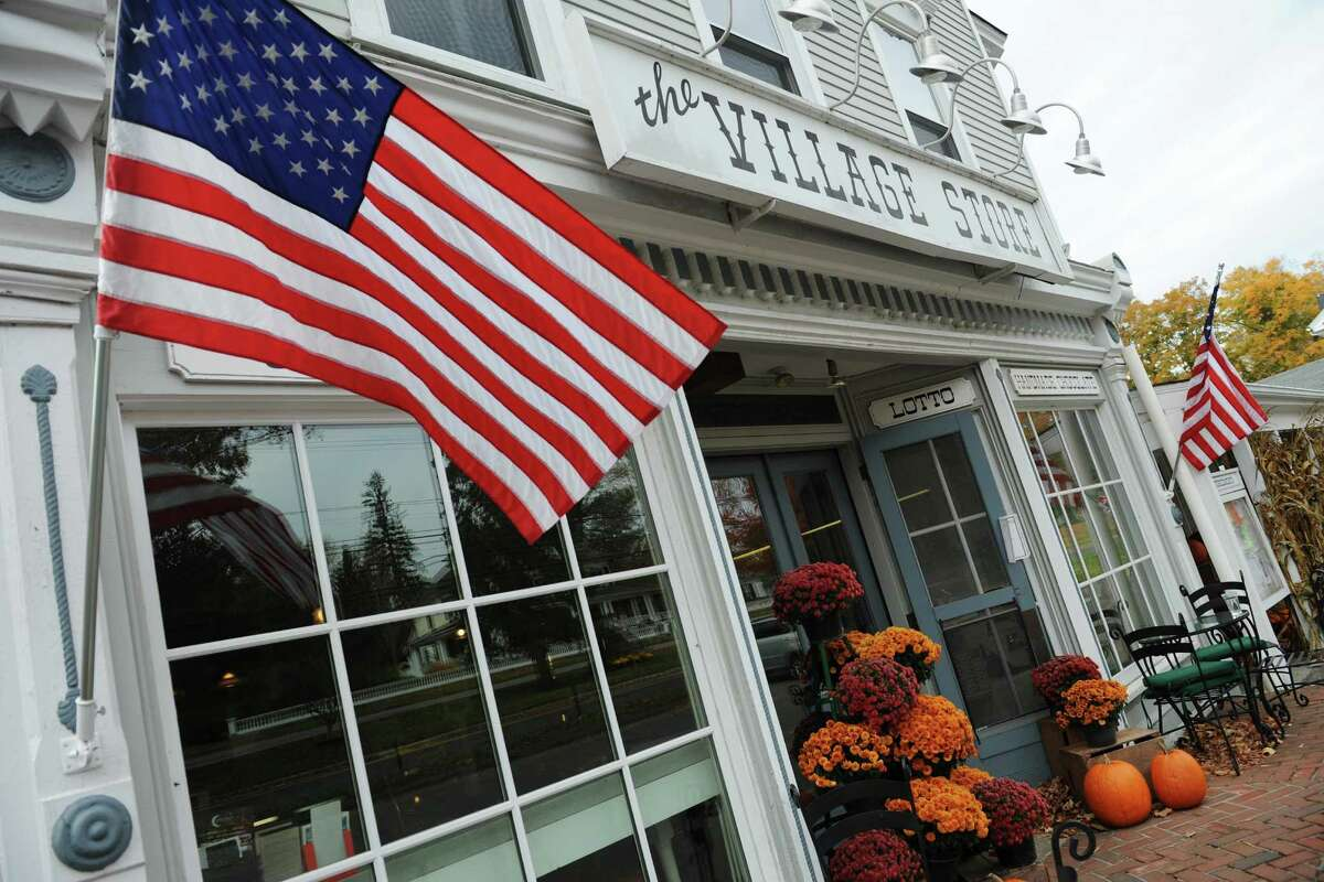 An American flag waves in the wind outside The Village Store in Bridgewater, Conn. Monday, Oct. 20, 2014. On Nov. 4, the town is voting on whether to allow the sale of alcohol at cafes and restaurants. If approved, the owner of The Village Store would like to sell wine from his vineyard in the store's restaurant.