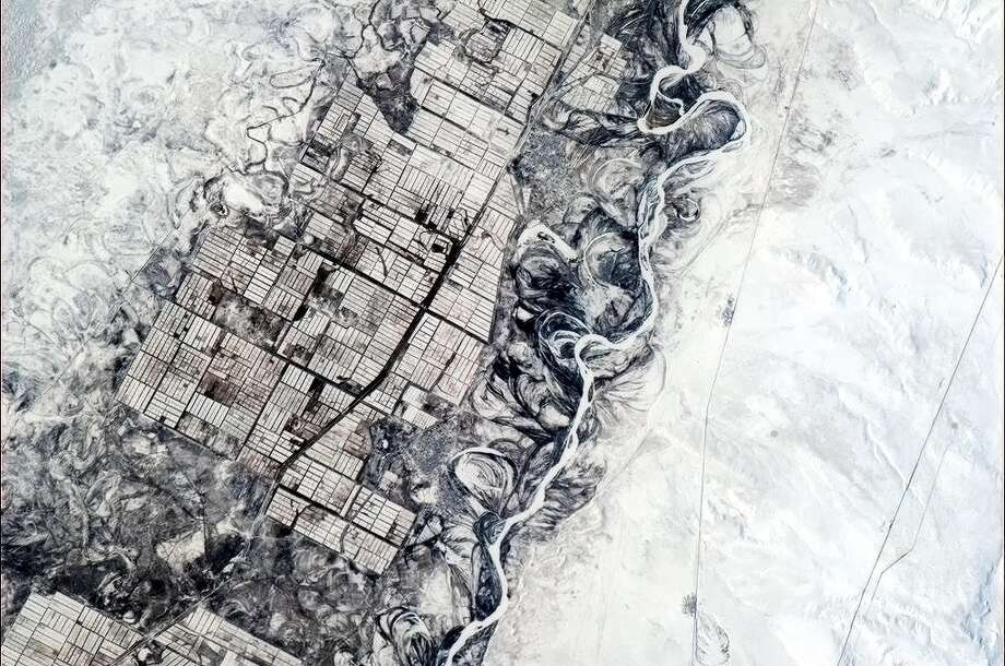 "Chris Hadfield Tweeted photos and observations from the International Space Station in late 2012 and early 2013. He Tweeted about this photo: ""Humans need straight lines, nature doesn't. Indecisive river and orderly farmers, central Asia."" Photo: Chris Hadfield, NASA / Twitter"