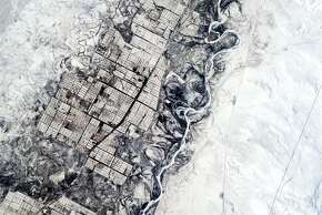 "Chris Hadfield Tweeted photos and observations from the International Space Station in late 2012 and early 2013. He Tweeted about this photo: ""Humans need straight lines, nature doesn't. Indecisive river and orderly farmers, central Asia."""