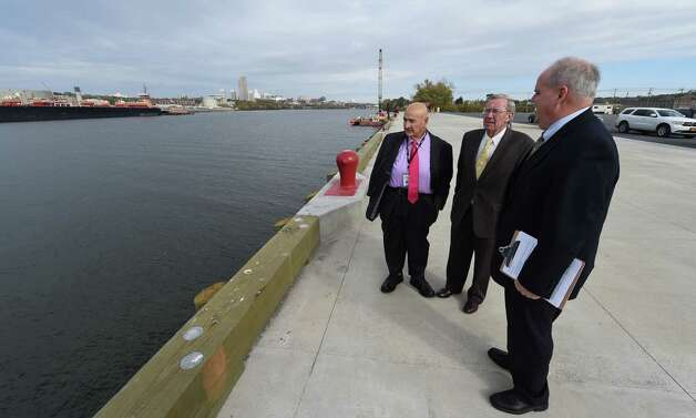 Rich Hendrick, general manager of the Port of Albany, right, shows off the new wharf to Port Commission member Dominic Tagliento, left, and Rensselaer Mayor Dan Dwyer, center, before a press conference Monday morning, Oct. 20, 2014, at the Port of Rensselaer in Rensselaer, N.Y.   (Skip Dickstein/Times Union) Photo: SKIP DICKSTEIN / 10029073A
