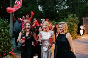 """No players in sight — but """"fans"""" cheered Sarah Harbaugh (center, in gold), the wife of 49ers head coach Jim Harbaugh, as she made an entrance with Susan Hanse (left) and friend Nancy Delis (right) at the Superball benefit for the 49ers Academy at Jillian Manus' home in Atherton, Calif., Friday, September 26, 2014."""
