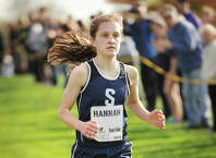 Staples' Hannah DeBalsi races to the finish to win the FCIAC Girls Cross Country Championships at Waveny Park in New Canaan, Conn. on Monday, October 20, 2014.