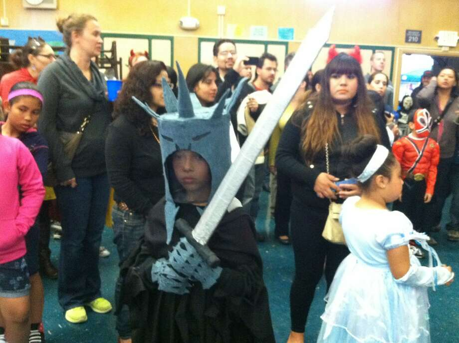 """The sword for this """"Lord of the Rings"""" Halloween costume was made out of common household items, including PVC pipe and athletic tape. Photo: Peter Hartlaub, The Chronicle"""