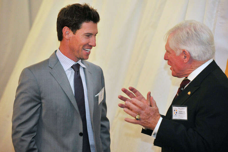 """Craig Breslow, left, chats with Jack Connolly during the Sports Night awards dinner at the Hyatt Regency in Greenwich, Conn., on Monday, Oct. 20, 2014. Breslow, a pitcher for the Boston Red Sox, is being inducted into the Fairfield County Sports Hall of Fame. Jack Connolly is accepting the hall of fame award for Harry """"Mickey"""" Connolly, a football player for Norwalk High School. Photo: Jason Rearick / Stamford Advocate"""