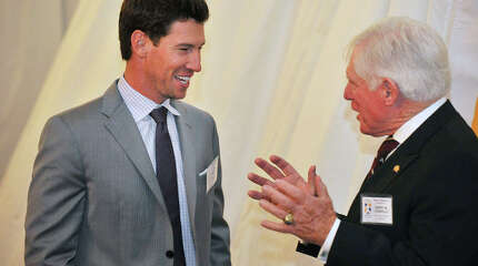 """Craig Breslow, left, chats with Jack Connolly during the Sports Night awards dinner at the Hyatt Regency in Greenwich, Conn., on Monday, Oct. 20, 2014. Breslow, a pitcher for the Boston Red Sox, is being inducted into the Fairfield County Sports Hall of Fame. Jack Connolly is accepting the hall of fame award for Harry """"Mickey"""" Connolly, a football player for Norwalk High School."""