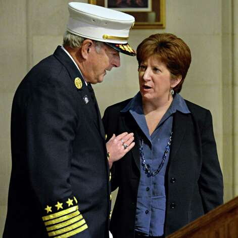 New Chief of the Department of Fire & Emergency Services for the City of Albany, Warren W. Abriel, Jr., left, speaks to Albany Mayor Kathy Sheehan Tuesday, Feb. 25, 2014, at City Hall in Albany, NY.  (John Carl D'Annibale / Times Union) Photo: John Carl D'Annibale / 00025861A