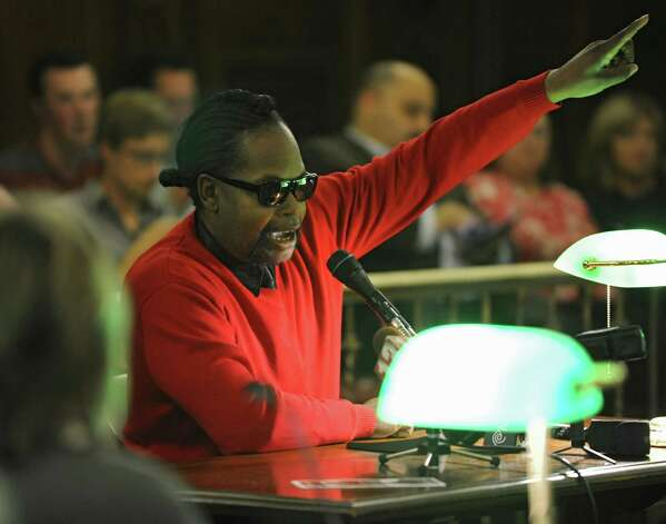 Marlon Anderson of Albany speaks in favor of red light cameras during the first public hearing on the mayors proposed budget for 2015 at Albany City Hall on Monday, Oct. 20, 2014 in Albany, N.Y. (Lori Van Buren / Times Union) Photo: Lori Van Buren / 10029014A