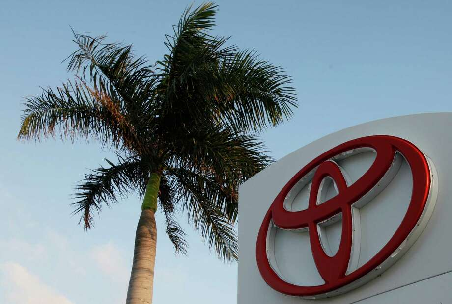 FILE - This Feb. 3, 2010 file photo shows a palm tree behind a Toyota sign at Earl Stewart Toyota in North Palm Beach, Fla. Toyota is recalling 247,000 vehicles in high-humidity areas as an air bag problem that has plagued most of the auto industry continues to widen. The recall covers vehicles in South Florida, along the Gulf Coast, in Puerto Rico, Hawaii, the U.S. Virgin Islands, Guam, Saipan and American Samoa. (AP Photo/Wilfredo Lee, File) Photo: Wilfredo Lee, STF / AP