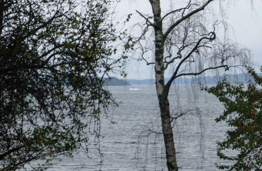 In this amateur photo provided by Sweden's armed forces and distributed by the TT News Agency on Sunday, Oct. 19, 2014, a partially submerged object is visible in the water at center, in the Stockholm archipelago, Sweden. The Swedish military said Sunday it had made three credible sightings of foreign undersea activity in its waters during the past few days amid reports of a suspected Russian intrusion in the area. (AP Photo/Swedish Armed Forces via TT News Agency) SWEDEN OUT Photo: SUB / Swedish Armed Forces via TT News