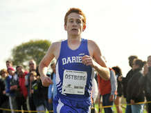 Darien's Alex Ostberg crosses the finish line first with the time of 14:47 during the boys FCIAC cross country championship at Waveny Park in New Canaan, Conn., on Monday, Oct. 20, 2014.